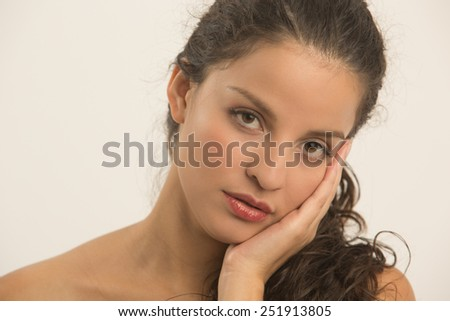 Woman showing her makeup looking at camera - stock photo