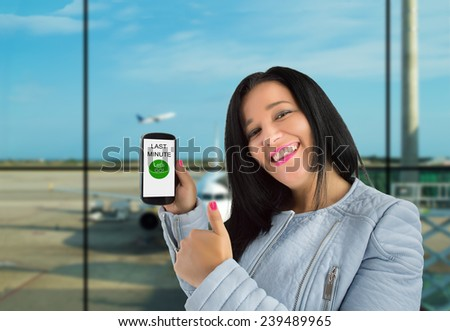 woman showing her phone and thumbs up by a last minute offer - stock photo