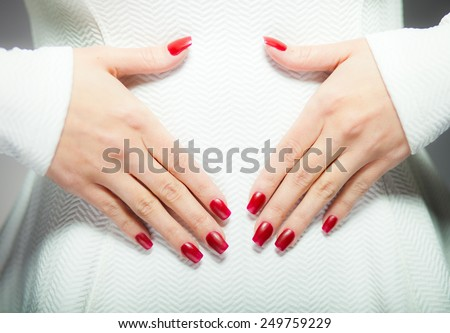 Woman showing her red nails, manicure concept - stock photo