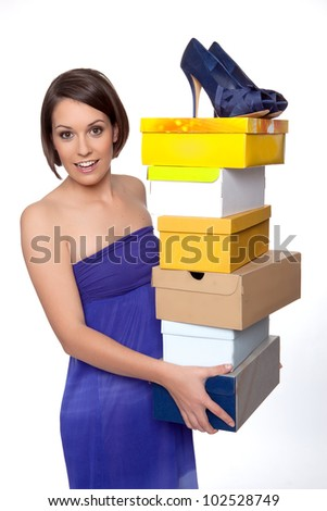 Woman showing her shoe collection - stock photo