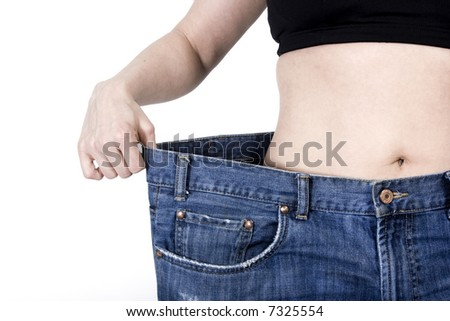 woman showing her weight loss - stock photo