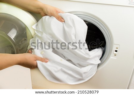 woman showing her white roma after washing - stock photo