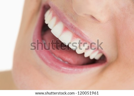 Woman showing her white smile while laughing - stock photo