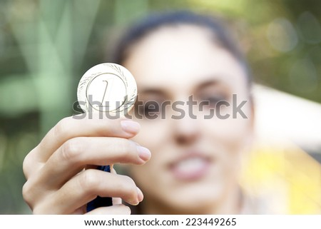 woman showing his medal - stock photo