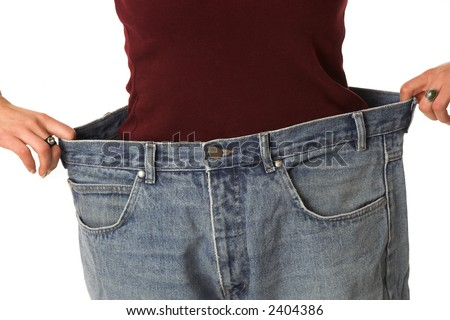 Woman showing how much she has lost by putting on an old pair of jeans