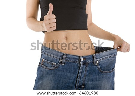 woman showing how much weight she lost - stock photo