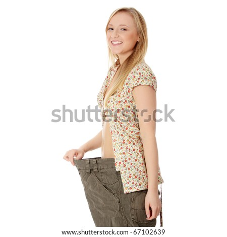 Woman showing how much weight she lost. Healthy lifestyles concept isolated on white background - stock photo