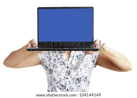 Woman showing laptop with blank screen as copy space - stock photo
