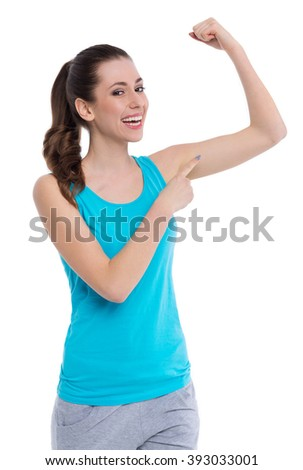 Woman showing muscle  - stock photo