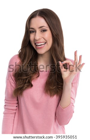 Woman showing OK sign  - stock photo