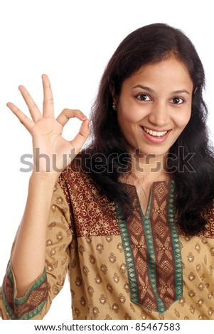 Woman showing OK sign against a white background