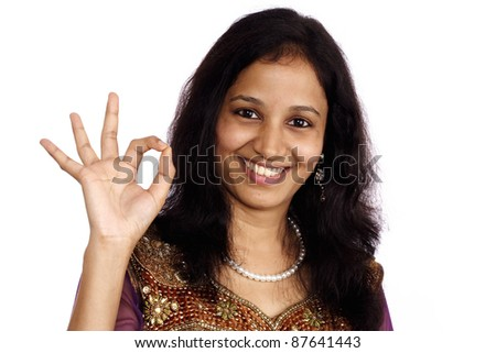 Woman showing OK sign against white background
