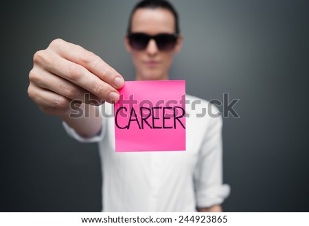 Woman showing paper with career sign on it - stock photo