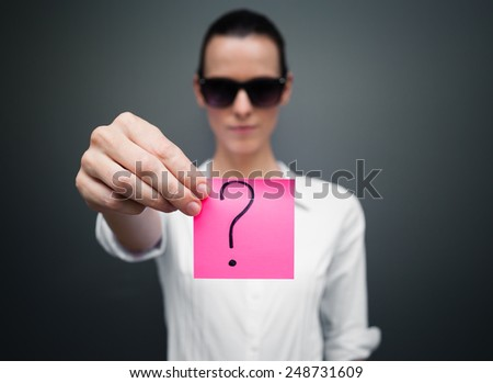 Woman showing paper with question mark on it - stock photo