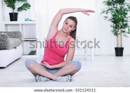 Woman showing Pilates stretching exercise