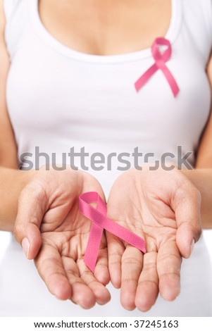 Woman showing pink ribbon to support breast cancer cause. PS : you can change the ribbon color to red to support AIDS cause