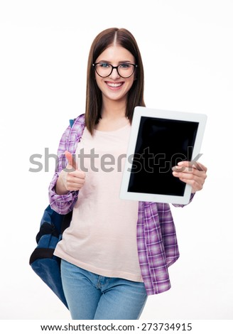 Woman showing tablet computer screen and thumb up over white background. Looking at camera - stock photo