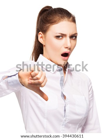 Woman showing thumbs down. Disgust - stock photo