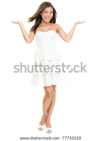Woman showing with two open hands. Beautiful lovely girl in white summer dress isolated on white background in full body. - stock photo