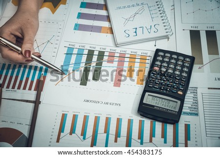 woman shows graphs for business. toned image - stock photo