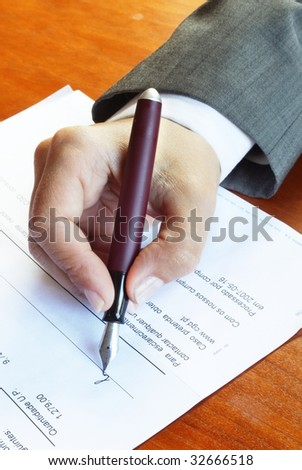 Woman signing document - stock photo