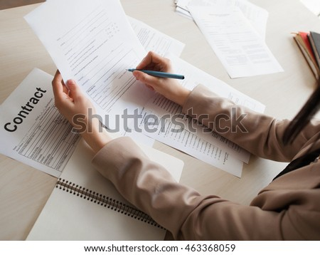 Woman signing employment contract. Close-up of female hands with pen, holding document form. Work, job, profession, occupation, recruitment concept