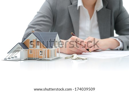 Woman signs purchase agreement for a  house - stock photo