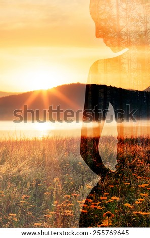 woman silhouette and nature abstract double exposure vertical background  - stock photo