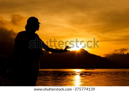 Woman silhouette and orange sky and sun set