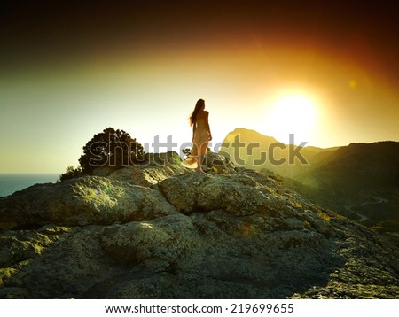 Woman silhouette at sunset in mountains. Crimea landscape - stock photo