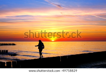 Woman silhouette in the sunset