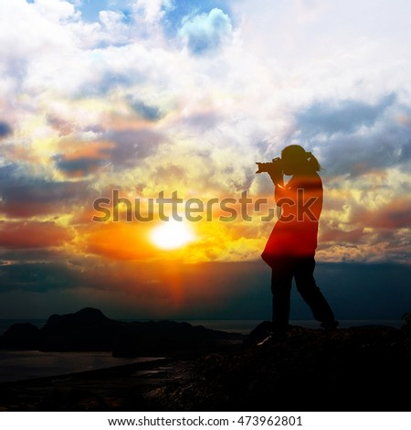 Woman silhouette standing on top of his photography.