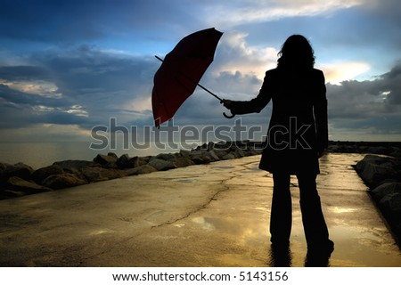 woman silhouette with umbrella - stock photo