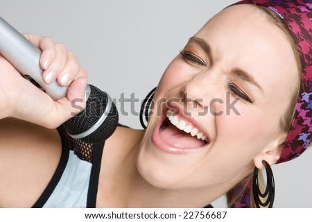 Woman Singing Karaoke - stock photo