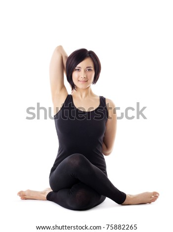 woman sit in yoga pose - cow face - stock photo