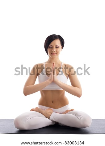 woman sit in yoga pose - lotos on rubber mat - stock photo