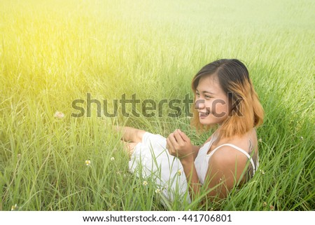 woman sit on green grass background