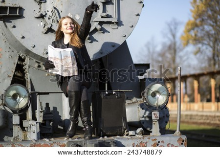 Woman sit on rusty train front lead way - stock photo