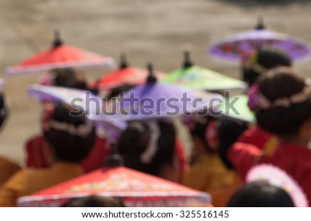 woman sit  with colorful umbrella for sun protection ,soft focus