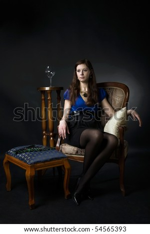 Woman sits in a chair - stock photo