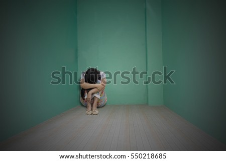woman sitting alone in a empty room