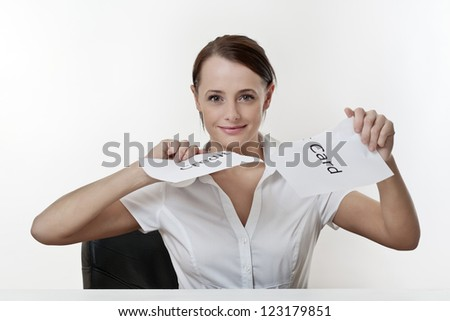woman sitting at a desk getting rid of her credit card worries - stock photo