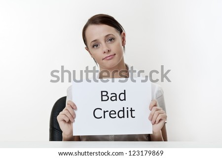 woman sitting at a desk with bad credit - stock photo