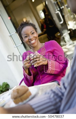 Woman sitting at cafe table, portrait - stock photo