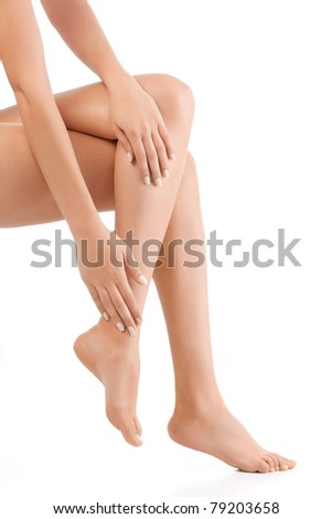 woman sitting down showing only legs and hands - stock photo