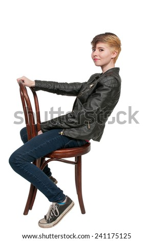 Woman sitting in a cane back chair - stock photo