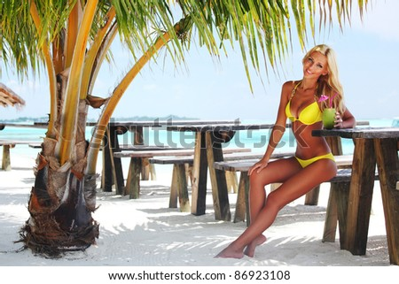 woman sitting in a tropical cafe