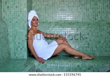 woman sitting in a Turkish bath resting - stock photo