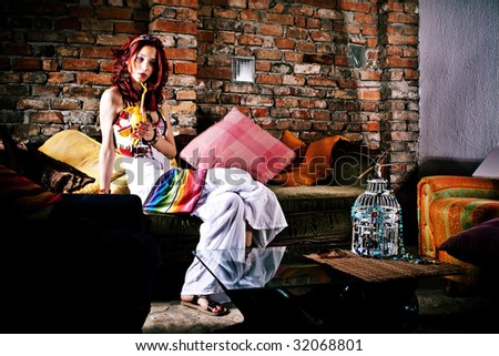 woman sitting in ambient, drinks juice - stock photo