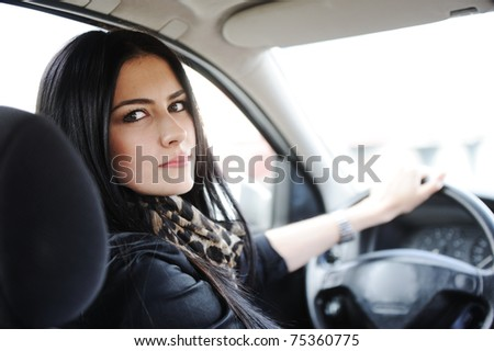 Woman Sitting In Car And Driving, back - stock photo